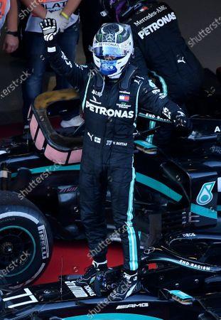 Mercedes driver Valtteri Bottas of Finland celebrates after winning the Russian Formula One Grand Prix, at the Sochi Autodrom circuit, in Sochi, Russia
