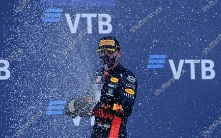 Red Bull driver Max Verstappen of the Netherlands celebrates on the podium after placing second in the Russian Formula One Grand Prix, at the Sochi Autodrom circuit, in Sochi, Russia