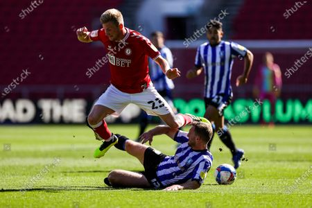 Taylor Moore of Bristol City is tackled by Tom Lees of Sheffield Wednesday