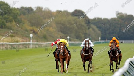 PERCY'S LAD (left, Charles Bishop) beats GOLDEN FLAME (centre) and LOVE IS GOLDEN (right) in The Call Star Sports Derby Wild Card Conditions Stakes Nottingham