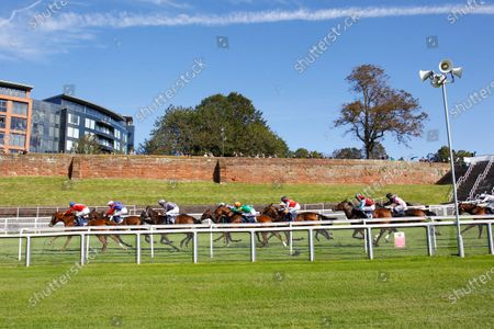 Horses head down the straight against the empty backdrop of the Chester walls at Chester's Behind Closed Doors fixture. Lady Sansa [green colours] and Harry Bentley in the centre of the group goes on to win the White Horse Fillies Handicap.