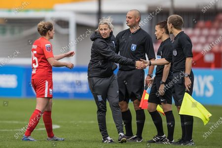 Birmingham City Defender Rebecca Holloway (25) goes over to congratulate Birmingham City Manager Carla Ward who is finishing off thanking the match officials; Jade Wardle (Assistant Referee), Rebecca Walsh (Referee) and Marcus Carmichael (Assistant Referee) following the Women's FA Cup match between Brighton and Hove Albion Women and Birmingham City Women at The People's Pension Stadium, Crawley