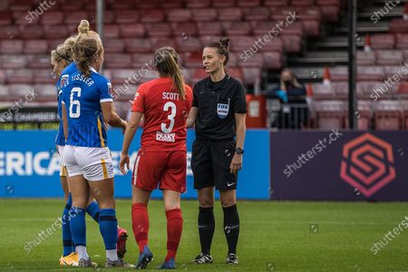 Rebecca Walsh (Referee) talking with Birmingham City Defender Harriet Scott (3) and Brighton & Hove Albion Defender MayaLe Tissier (6) during the Women's FA Cup match between Brighton and Hove Albion Women and Birmingham City Women at The People's Pension Stadium, Crawley