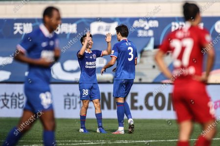 Bi Jinhao (2nd R) of Shanghai Greenland Shenhua celebrates a goal with teammate Wen Jiabao (2nd L) during the 14th round match between Shanghai Greenland Shenhua and Henan Jianye at the postponed 2020 season Chinese Football Association Super League (CSL) Dalian Division in Dalian, northeast China's Liaoning Province, Sept. 27, 2020.