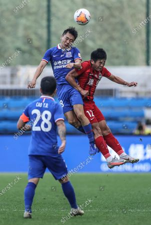 Stock Image of Wen Jiabao (Top) of Shanghai Greenland Shenhua vies with Du Changjie of Henan Jianye during the 14th round match between Shanghai Greenland Shenhua and Henan Jianye at the postponed 2020 season Chinese Football Association Super League (CSL) Dalian Division in Dalian, northeast China's Liaoning Province, Sept. 27, 2020.