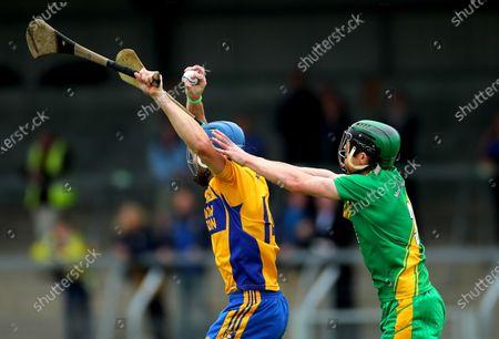 O'Callaghans Mills vs Sixmilebridge. Sixmilebridge's Alex Morey and Conor Cooney of O'Callahan Mills
