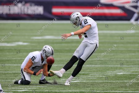 Stock Image of Las Vegas Raiders punter AJ Cole (6) holds for kicker Daniel Carlson (2) prior to the start of second half of an NFL football game against the New England Patriots, in Foxborough, Mass