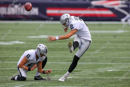 Las Vegas Raiders punter AJ Cole (6) holds for kicker Daniel Carlson (2) prior to the start of second half of an NFL football game against the New England Patriots, in Foxborough, Mass