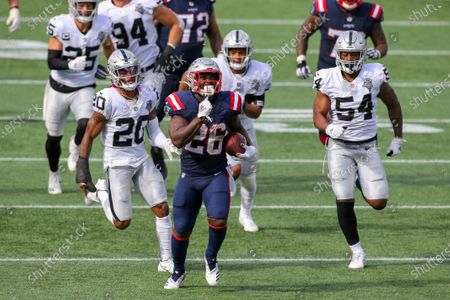 New England Patriots running back Sony Michel (26) is chased by Las Vegas Raiders defensive back Damon Arnette (20) and linebacker Raekwon McMillan (54) during the second half of an NFL football game, in Foxborough, Mass
