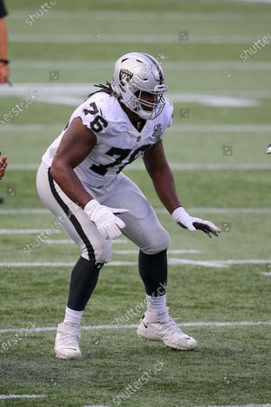 Stock Photo of Las Vegas Raiders guard John Simpson (76) during the second half of an NFL football game against the New England Patriots, in Foxborough, Mass