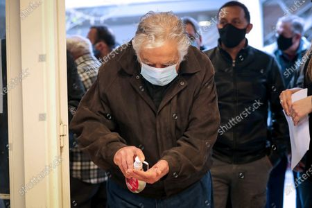 Uruguayan former president Jose Mujica disinfects his hands with hydroalcoholic gel before exercising his right to vote, during the departmental elections, in Montevideo, Uruguay, 27 September 2020. 2.7 million citizens are called to vote in the 7.130 voting centers that opened their doors this Sunday in Uruguay to elect the rulers of their departments (provinces) and municipalities for the period 2020-2025.