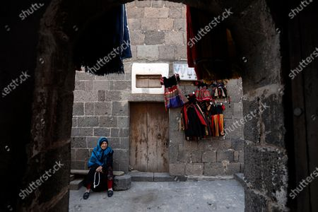 A Yemeni woman sits at the tourist site of the Dar al-Hajar (Rock Palace) on World Tourism Day at the village of Wadi Dhahr on the outskirts of Sana'a, Yemen, 27 September 2020. The historical five-storey palace of Dar al-Hajar (Rock Palace), one of Yemen's most popular tourist destinations, was built in 1786 AD, perching atop a rock pinnacle on the outskirts of Sana'a. World Tourism Day is commemorated each year on 27 September with this year's theme focusing on 'Tourism and Rural Development'.