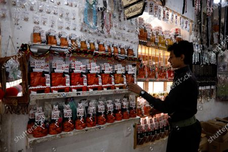 A Yemeni browses inside a shop of gifts at the tourist site of the Dar al-Hajar (Rock Palace) on World Tourism Day at the village of Wadi Dhahr on the outskirts of Sana'a, Yemen, 27 September 2020. The historical five-storey palace of Dar al-Hajar (Rock Palace), one of Yemen's most popular tourist destinations, was built in 1786 AD, perching atop a rock pinnacle on the outskirts of Sana'a. World Tourism Day is commemorated each year on 27 September with this year's theme focusing on 'Tourism and Rural Development'.