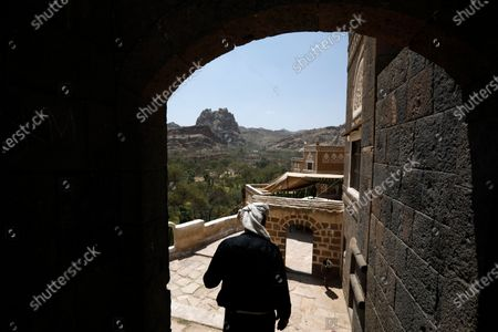 A Yemeni visits the tourist site of the Dar al-Hajar (Rock Palace) on World Tourism Day at the village of Wadi Dhahr on the outskirts of Sana'a, Yemen, 27 September 2020. The historical five-storey palace of Dar al-Hajar (Rock Palace), one of Yemen's most popular tourist destinations, was built in 1786 AD, perching atop a rock pinnacle on the outskirts of Sana'a. World Tourism Day is commemorated each year on 27 September with this year's theme focusing on 'Tourism and Rural Development'.