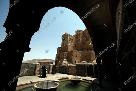 Yemenis visit the tourist site of the Dar al-Hajar (Rock Palace) on World Tourism Day at the village of Wadi Dhahr on the outskirts of Sana'a, Yemen, 27 September 2020. The historical five-storey palace of Dar al-Hajar (Rock Palace), one of Yemen's most popular tourist destinations, was built in 1786 AD, perching atop a rock pinnacle on the outskirts of Sana'a. World Tourism Day is commemorated each year on 27 September with this year's theme focusing on 'Tourism and Rural Development'.