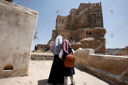Two Yemeni girls take a selfie in front of the Dar al-Hajar (Rock Palace) on World Tourism Day at the village of Wadi Dhahr on the outskirts of Sana'a, Yemen, 27 September 2020. The historical five-storey palace of Dar al-Hajar (Rock Palace), one of Yemen's most popular tourist destinations, was built in 1786 AD, perching atop a rock pinnacle on the outskirts of Sana'a. World Tourism Day is commemorated each year on 27 September with this year's theme focusing on 'Tourism and Rural Development'.