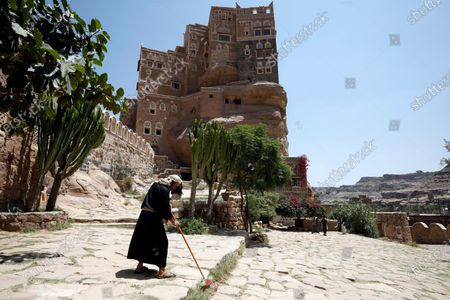A Yemeni worker cleans the yard of the tourist site of the Dar al-Hajar (Rock Palace) on World Tourism Day at the village of Wadi Dhahr on the outskirts of Sana'a, Yemen, 27 September 2020. The historical five-storey palace of Dar al-Hajar (Rock Palace), one of Yemen's most popular tourist destinations, was built in 1786 AD, perching atop a rock pinnacle on the outskirts of Sana'a. World Tourism Day is commemorated each year on 27 September with this year's theme focusing on 'Tourism and Rural Development'.