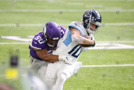 Tennessee Titans wide receiver Adam Humphries is tackled by Minnesota Vikings linebacker Eric Wilson (50) after catching a pass during the second half of an NFL football game, in Minneapolis