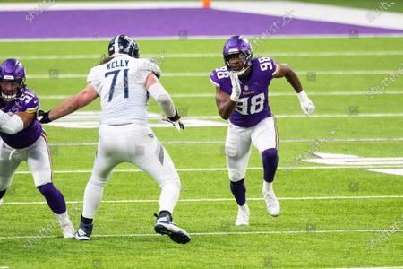 Minnesota Vikings defensive end D.J. Wonnum (98) in action against Tennessee Titans offensive tackle Dennis Kelly (71) in the fourth quarter during an NFL football game, in Minneapolis. The Titans defeated the Vikings 31-20