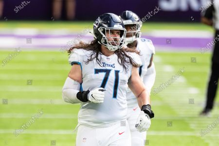 Tennessee Titans offensive tackle Dennis Kelly (71) looks on in the second quarter during an NFL football game against the Minnesota Vikings, in Minneapolis. The Titans defeated the Vikings 31-30