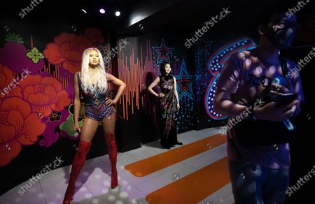 A visitor walk past a wax figurine of American singer Beyonce (L) at Madame Tussauds Singapore in Sentosa, Singapore, 27 September 2020. As the Covid-19 pandemic batters the tourism industry in Singapore with borders remaining largely closed top overseas visitors, the city state is turning to domestic tourists instead. The Singapore Tourism Board has launched a campaign in July to entice Singapore residents to spend on local hotels and attractions and ÔrediscoverÕ the island. World Tourism Day is celebrated on 27 September annually.