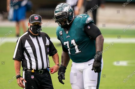 Philadelphia Eagles offensive tackle Jason Peters (71) looks on with umpire Paul King (121) during the NFL football game against the Cincinnati Bengals, in Philadelphia