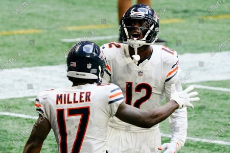 Chicago Bears wide receiver Anthony Miller (17) celebrates his touchdown with Chicago Bears wide receiver Allen Robinson (12) against the Atlanta Falcons during the second half of an NFL football game, in Atlanta