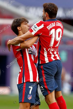 Diego Costa of Atletico de Madrid celebrates after scoring the 1-0 with his teammate Joao Felix