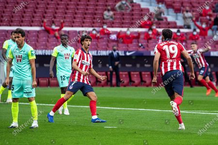 Atletico Madrid's striker Diego Costa (R) celebrates with teammate Joao Felix (C) after scoring the 1-0 goal during the Spanish Laliga soccer match between Atletico Madrid and Granada held at Wanda Metropolitano Stadium, in Madrid, central Spain, 27 September 2020.