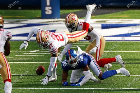 San Francisco 49ers cornerback Dontae Johnson (27) strips the ball from New York Giants wide receiver Darius Slayton (86) during an NFL football game, in East Rutherford, N.J