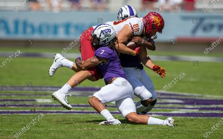Stock Image of Safeties Trevon Moehrig (7) and La'Kendrick Van Zandt (20) tackle Iowa State tight end Charlie Kolar (88) during an NCAA football game on in Fort Worth, Texas. Iowa State won 37-34