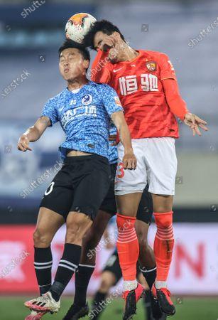 Park Ji Soo (R) of Guangzhou Evergrande Taobao vies the ball with Wang Jinxian of Dalian Pro during the 14th round match between Guangzhou Evergrande Taobao and Dalian Pro at the postponed 2020 season Chinese Football Association Super League (CSL) Dalian Division in Dalian, northeast China's Liaoning Province, Sept. 27, 2020.