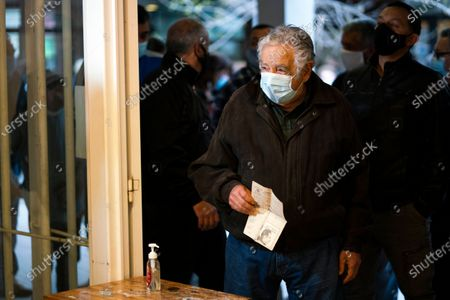 Uruguayan former President Jose Mujica arrives at a polling station to cast his vote during the municipal election in Montevideo, Uruguay