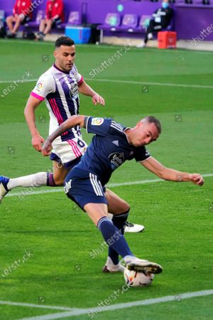 Celta Vigo's striker Iago Aspas (C) scores the 0-1 goal during the Spanish Laliga soccer match between Real Valladolid and Celta Vigo held at Jose Zorrilla Stadium, in Valladolid, Spain, 27 September 2020.