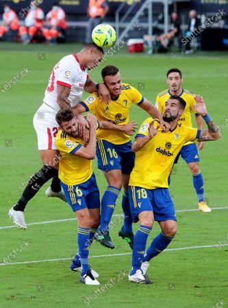 Cadiz's midfielder Jose Mari (2-L), defender Juan Cala (2-R) and striker Alvaro Negredo (R) in action against Sevilla's defender Diego Carlos (L)  during the Spanish LaLiga soccer match between Cadiz CF and Sevilla FC held at Ramon de Carranza Stadium, in Cadiz, southern Spain, 27 September 2020.