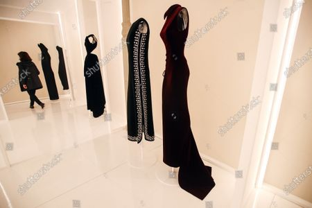 Creations designed by Tunisian fashion designer Azzedine Alaia (R and L) andby Spanish fashion designer Cristobal Balenciaga (C) are displayed during the 'Alaia et Balenciaga - Sculpteurs de la forme' exhibition at Azzedine Alaia Foundation in Paris, France, 27 September 2020. The 2020 Paris Fashion Week runs from 28 September to 06 October 2020.