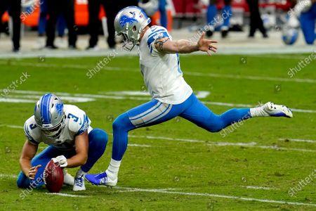 Detroit Lions kicker Matt Prater kicks the field goal as punter Jack Fox (3) holds during the second half of an NFL football game against he Arizona Cardinals, in Glendale, Ariz. The Lions won 26-23
