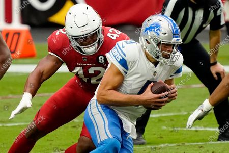 Detroit Lions quarterback Matthew Stafford (9) is sacked by Arizona Cardinals outside linebacker Devon Kennard (42) during the first half of an NFL football game, in Glendale, Ariz