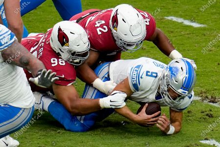 Detroit Lions quarterback Matthew Stafford (9) is sacked by Arizona Cardinals outside linebacker Devon Kennard (42) and defensive tackle Corey Peters (98) during the first half of an NFL football game, in Glendale, Ariz