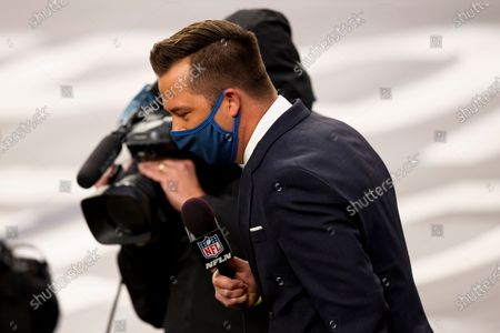 Network reporter James Palmer reports from the sidelines in the second half of an NFL football game between the Denver Broncos and the Tampa Bay Buccaneers, in Denver
