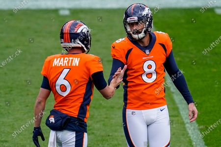 Denver Broncos kicker Brandon McManus (8) celebrates with Sam Martin after a field goal against the Tampa Bay Buccaneers during an NFL football game, in Denver