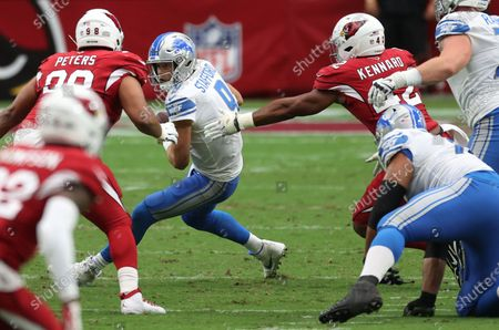 Detroit Lions quarterback Matthew Stafford (C) is sacked by Arizona Cardinals Corey Peters (L) and Devon Kennard (R), during the first quarter of their NFL game in Glendale, Arizona, USA, 27 September 2020.