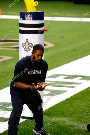 New Orleans Saints defensive end Cam Jordan warms up against a goal pad with the Inspire Change logo, while wearing a shirt with a statement in solidarity with the Black Lives Matter movement, before an NFL football game against the Green Bay Packers in New Orleans