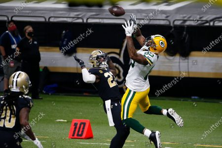 Green Bay Packers tight end Marcedes Lewis (89) pulls in a touchdown reception in front of New Orleans Saints strong safety Malcolm Jenkins (27) in the second half of an NFL football game in New Orleans
