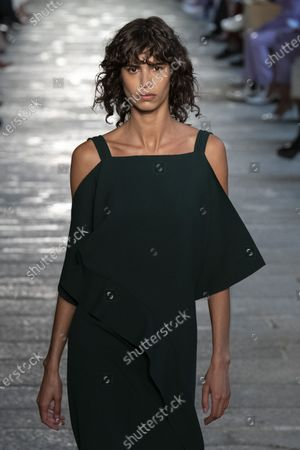 Mica Arganaraz on the catwalk wearing an outfit from the women s ready to wear collections, spring summer 2021, original creation, during the Womenswear Fashion Week in Milan, from the house of Boss