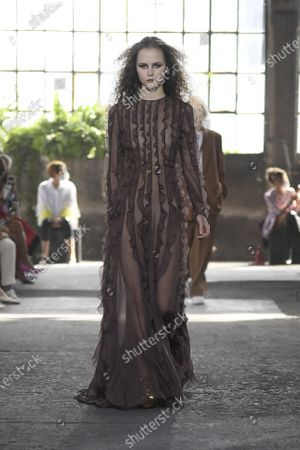 A Model wearing an outfit from the women s ready to wear collections, spring summer 2021, original creation, during the Womenswear Fashion Week in Milan, from the house of Valentino