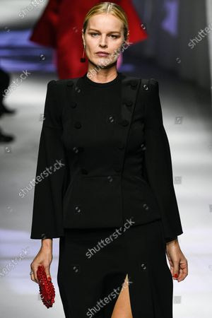 Eva Herzigova on the catwalk wearing an outfit from the women s ready to wear collections, spring summer 2021, original creation, during the Womenswear Fashion Week in Milan, from the house of Fendi