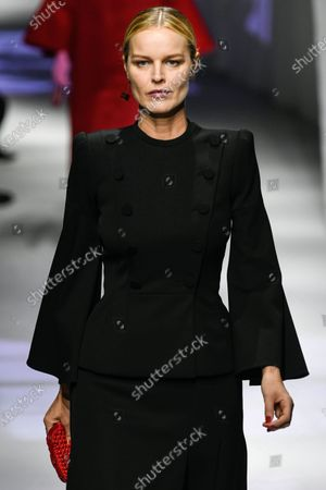Stock Image of Eva Herzigova on the catwalk wearing an outfit from the women s ready to wear collections, spring summer 2021, original creation, during the Womenswear Fashion Week in Milan, from the house of Fendi