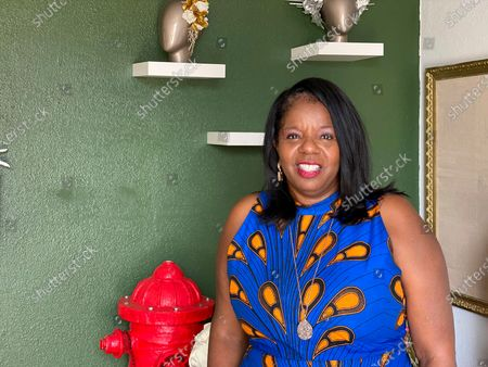 """Cathy Adams, president and chief executive officer of the Oakland African American Chamber of Commerce, poses for a photo, in Oakland, Calif. The chamber raised about $1 million for a """"Resiliency Fund"""" to help Black-owned businesses stay afloat during the coronavirus pandemic"""