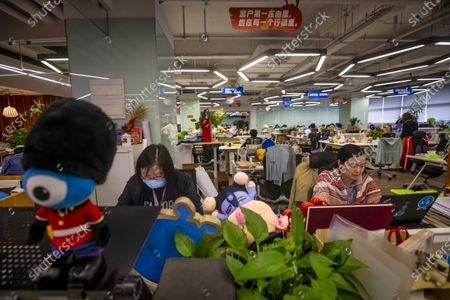 People work in an office within the Ant Group headquarters in Hangzhou, China, 27 September 2020 (issued 28 September 2020). Ant Group is the parent company of China's largest mobile payments business Alipay and leading provider of financial services technology. The Alipay mobile application serves over 1 billion annual active users, according to the company. Ant group is an affiliate company of the Alibaba Group founded by billionaire Jack Ma and it is preparing a simultaneous initial public offering (IPO) in Hong Kong and Shanghai.